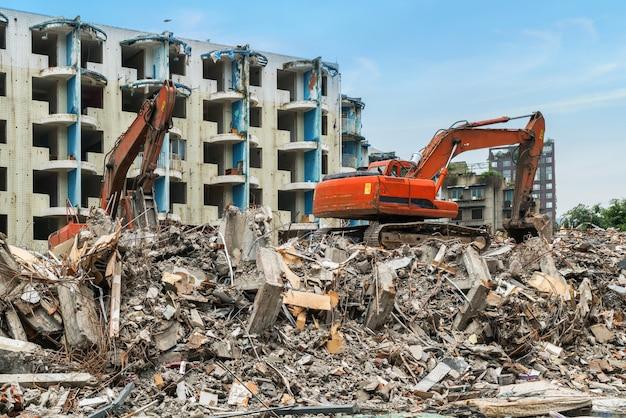 Excavator in demolition of housing