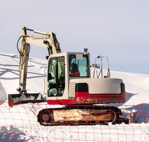 Excavator or digger with shovel. industrial machine for earth and snow moving