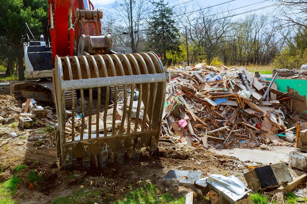 Excavator disassembles broken house after tragedy