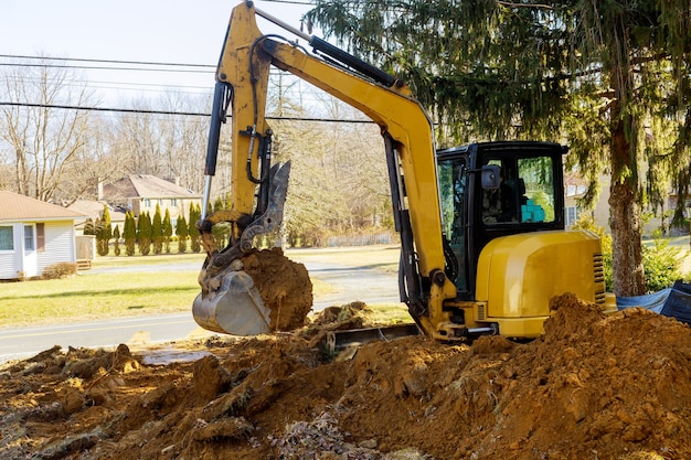 Excavator loader at earth moving works around the construction site