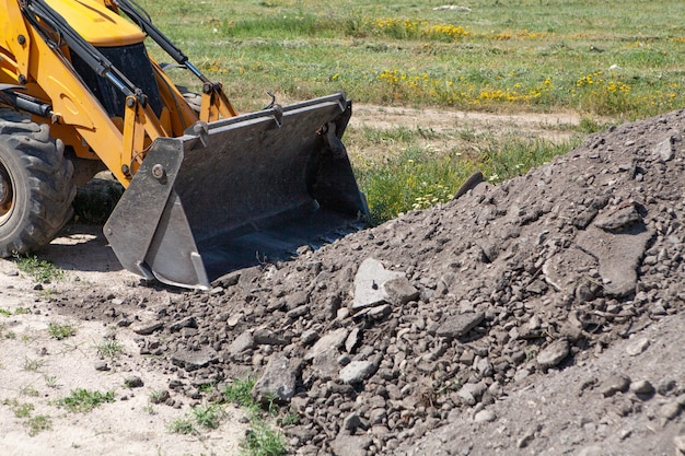 Excavator and new building in the field