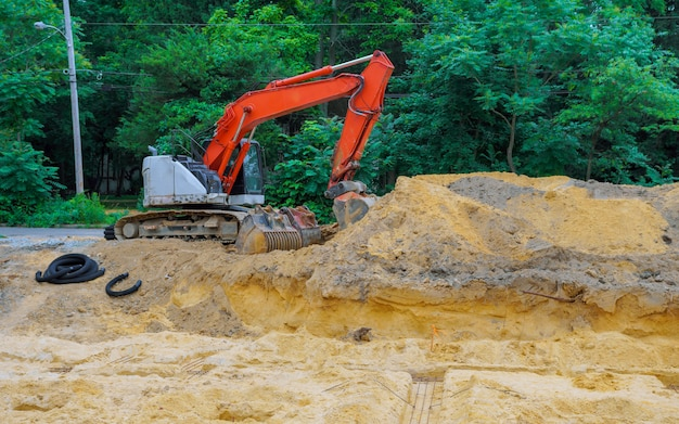 Excavator work on the preparation of the excavation for the foundation of residential complex