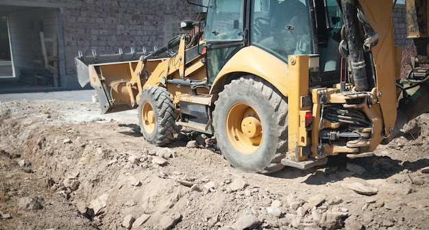 Excavator works at a construction site.