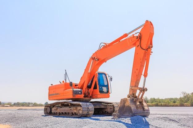 Excavators machine on a construction site on a construction site against blue sky