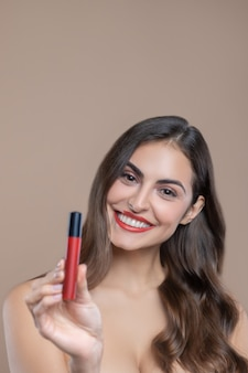 Excellent choice. attractive smiling woman tilted head to side with bare shoulders showing lip gloss