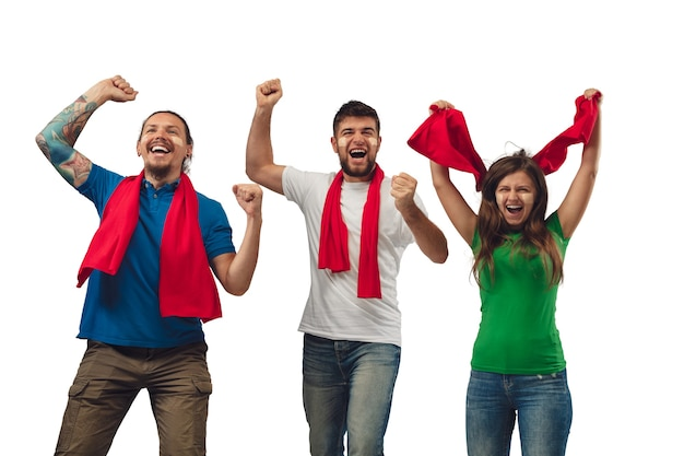Excellent goal. three soccer fans woman and men cheering for favourite sport team with bright emotions isolated on white studio background. looking excited, supporting. concept of sport, fun, support.