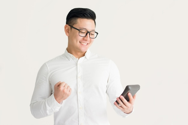 Excited accountant calculating company budget