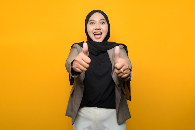 Excited asian woman wearing hijab