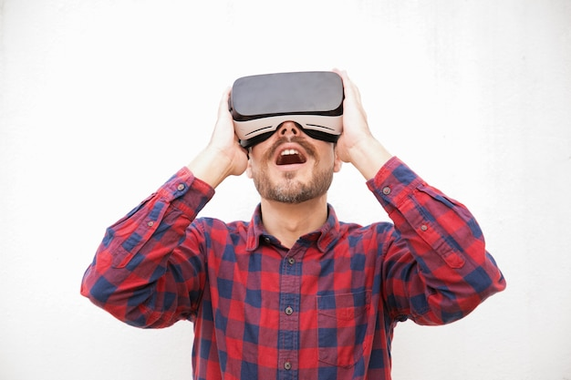Excited bearded man in vr headset