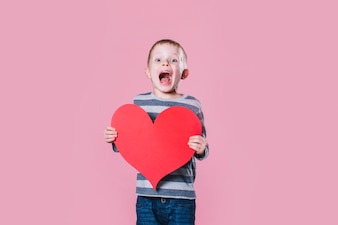 Excited boy with heart