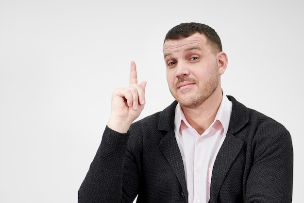 Excited businessman having an idea and pointing finger up