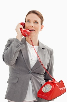 Excited businesswoman talking on the phone