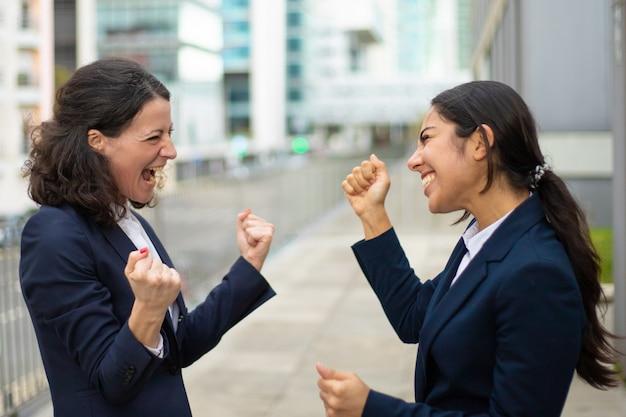 Excited businesswomen celebrating success