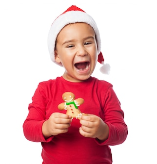 Excited child showing his gingerbread