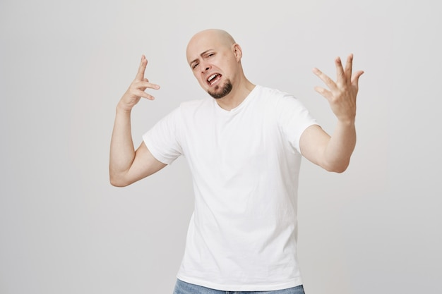 Excited cool bald guy dancing and singing