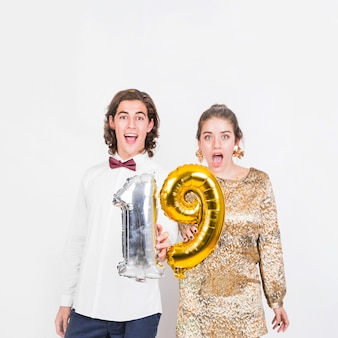 Excited couple holding balloons 19