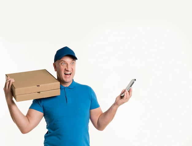 Excited delivery man holding phone and pizza boxes