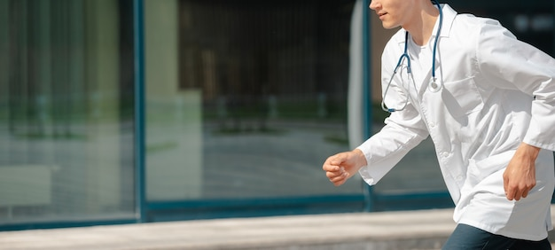 Excited doctor confidently runs to the patient