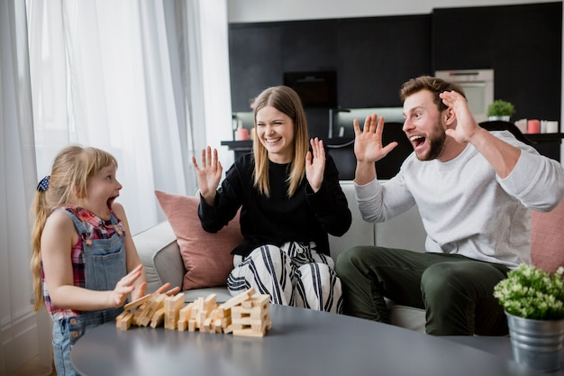 Excited family playing jenga