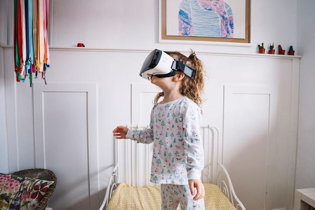Excited girl in vr glasses looking around