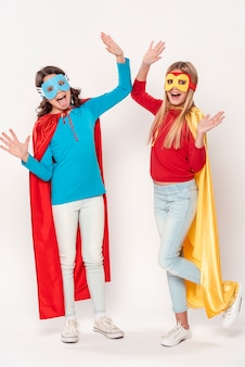 Excited girls with hero costumes