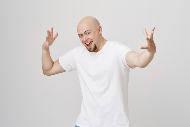 Excited happy bald guy dancing and singing