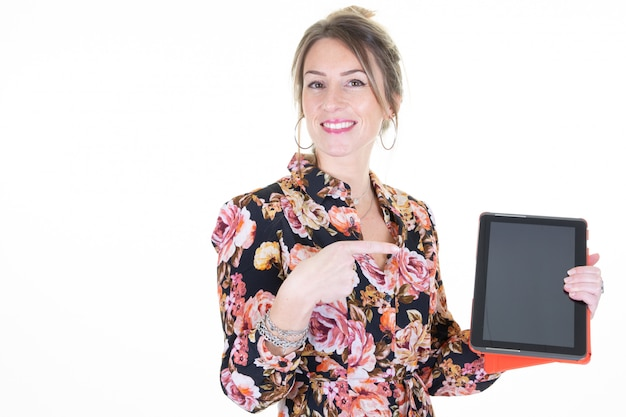 Excited happy beautiful woman pointing holding tablet computer empty screen