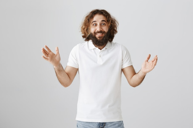 Excited happy middle-eastern man telling big news