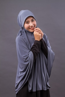 Excited happy smiling smart casual muslim asian woman posing cheerful, successful pose