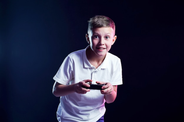 Excited kid playing video game in