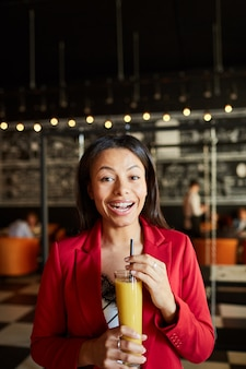 Excited lady drinking alcoholic cocktail