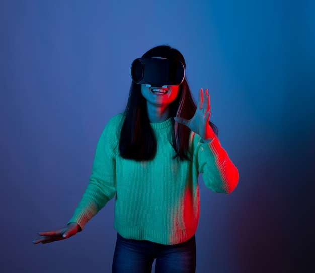 Excited lady wearing vr wants to take something