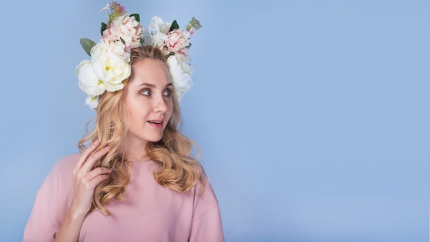 Excited lady with flowers on head