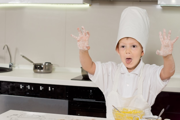 Excited little boy doing the baking