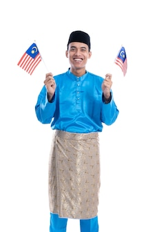 Excited malaysian male muslim with flag over white background