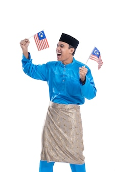 Excited malaysian man with flag