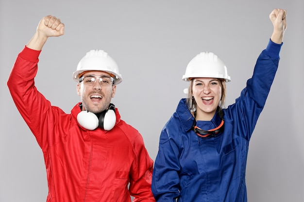 Excited male and female construction workers