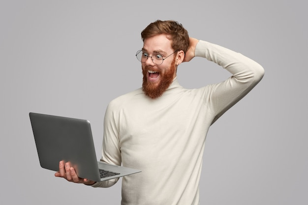 Excited male noticed amazing deal in internet