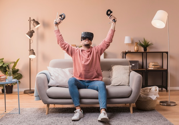 Excited male with virtual headset