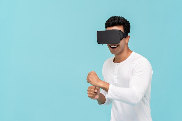 Excited man enjoying watching video from vr glasses