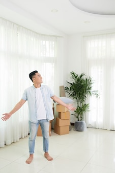Excited man happy with new apartment