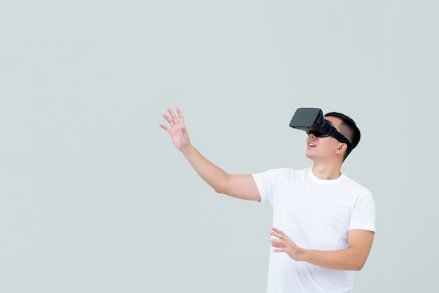 Excited man reaching hand out while watching  3d simulation video on vr glasses