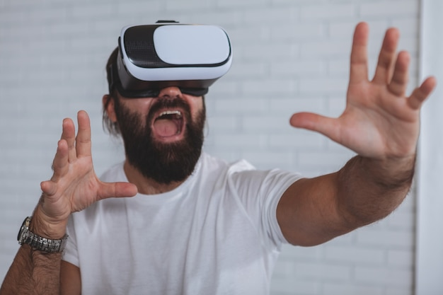 Excited man using vr glasses