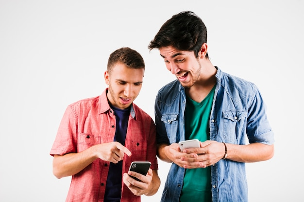 Excited men watching smartphones