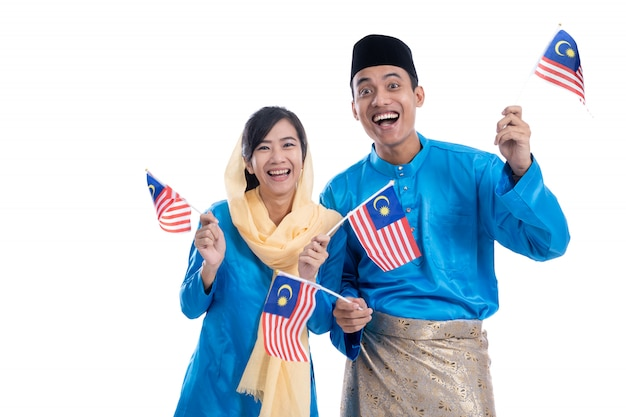 Excited muslim couple with malaysian flag