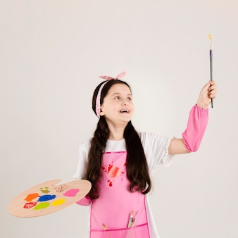 Excited painter holding paint brush
