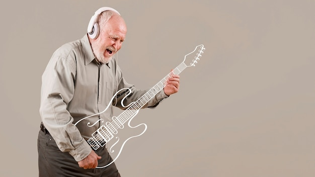 Excited senior playing imaginary guitar