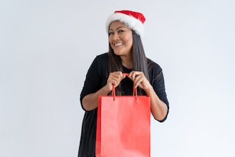 Excited shopper happy about Christmas purchases