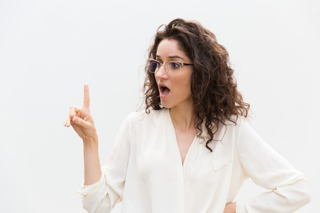 Excited surprised woman in glasses with open mouth