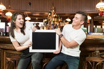 Excited waiters with chalkboard